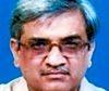 Dr. Kishore Chandorkar